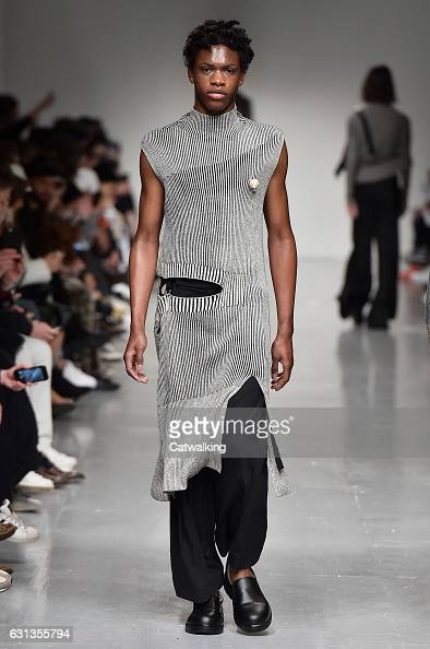 A model walks the runway at the Ximon Lee Autumn Winter 2017 fashion show during London Menswear Fashion Week on January 8 2017 in London United...