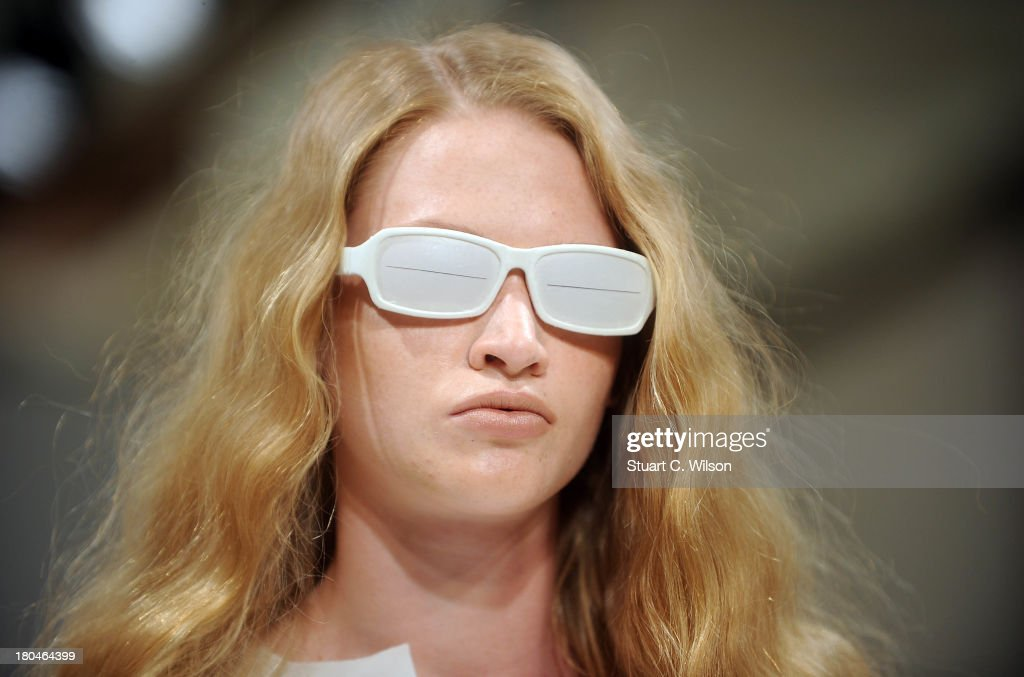 A model walks the runway at the Yifang Wan show during at the Fashion Scout venue during London Fashion Week SS14 at Freemasons Hall on September 13, 2013 in London, England.