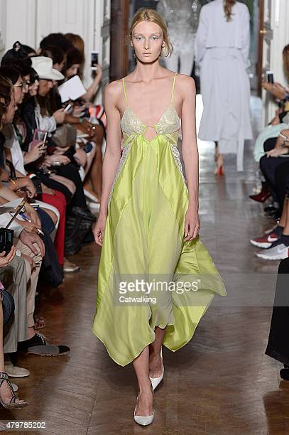 A model walks the runway at the Yiqing Yin Autumn Winter 2015 fashion show during Paris Haute Couture Fashion Week on July 7 2015 in Paris France