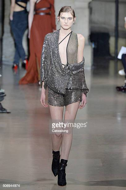 A model walks the runway at the Yiqing Yin Spring Summer 2016 fashion show during Paris Haute Couture Fashion Week on January 26 2016 in Paris France