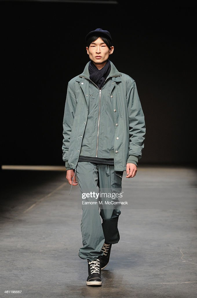 A model walks the runway at the YMC show during The London Collections Men Autumn/Winter 2014 on January 7 2014 in London England