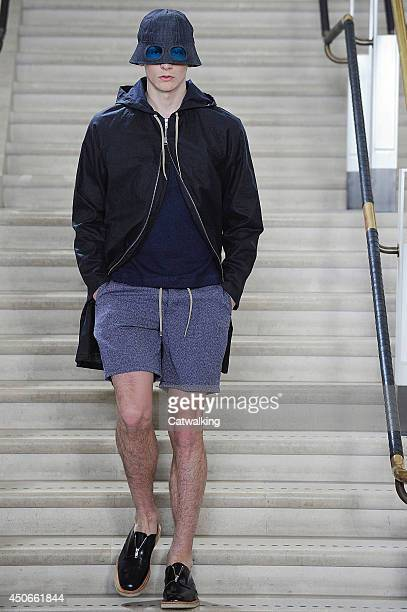 A model walks the runway at the YMC Spring Summer 2015 fashion show during London Menswear Fashion Week on June 15 2014 in London United Kingdom