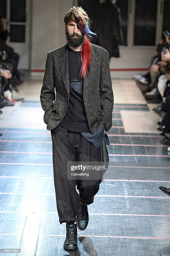 A model walks the runway at the Yohji Yamamoto Autumn Winter 2014 fashion show during Paris Menswear Fashion Week on January 16, 2014 in Paris, France.