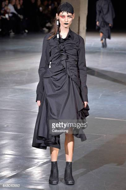 A model walks the runway at the Yohji Yamamoto Autumn Winter 2017 fashion show during Paris Fashion Week on March 3 2017 in Paris France