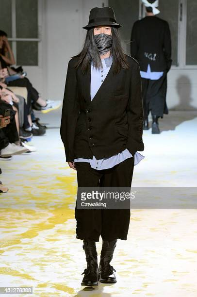 A model walks the runway at the Yohji Yamamoto Spring Summer 2015 fashion show during Paris Menswear Fashion Week on June 26 2014 in Paris France