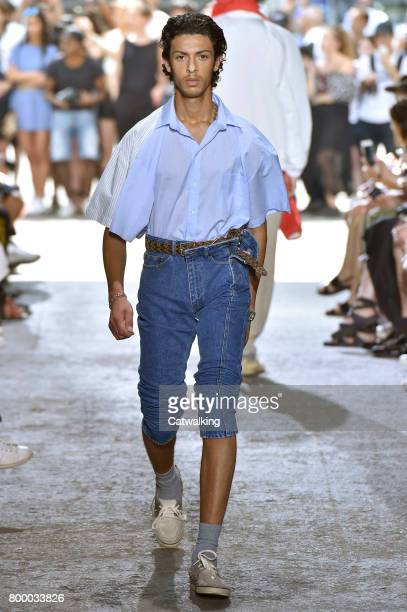 A model walks the runway at the YProject Spring Summer 2018 fashion show during Paris Menswear Fashion Week on June 21 2017 in Paris France