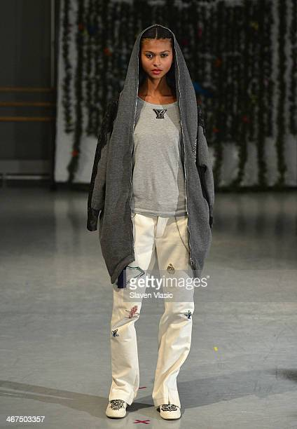A model walks the runway at the Yuna Yang fashion show during MercedesBenz Fashion Week Fall 2014 at Alvin Alley Studios on February 6 2014 in New...