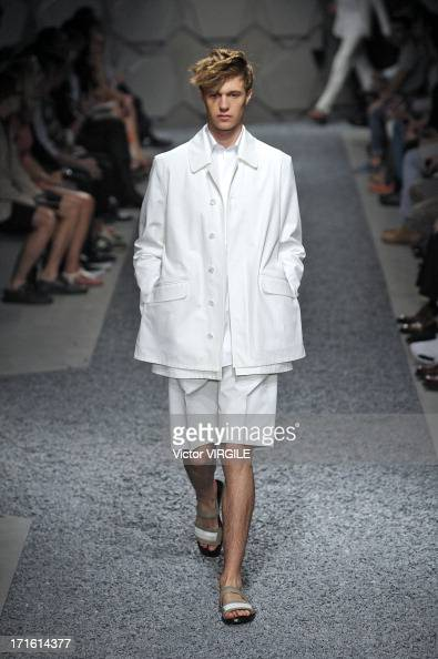 A model walks the runway at the Z Zegna show during Milan Menswear Fashion Week Spring Summer 2014 on June 25 2013 in Milan Italy
