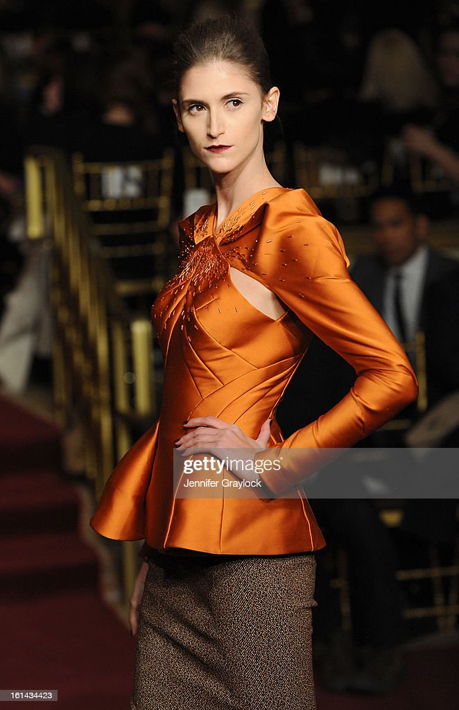 A model walks the runway at the Zac Posen Fall 2013 Mercedes-Benz Fashion Show at The Plaza Hotel on February 10, 2013 in New York City.