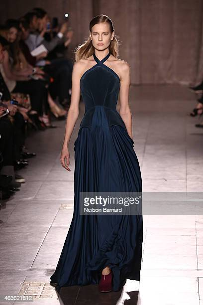 A model walks the runway at the Zac Posen fashion show during MercedesBenz Fashion Week Fall 2015 at Vanderbilt Hall at Grand Central Terminal on...