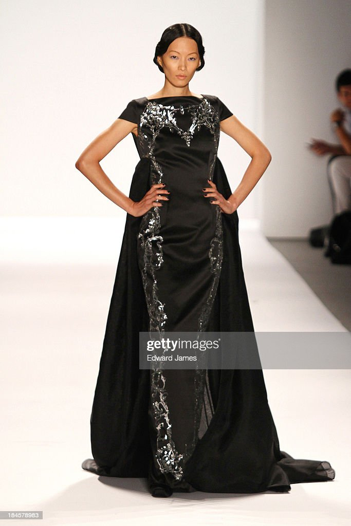 A model walks the runway at the Zang Toi fashion show during Mercedes-Benz Fashion Week Spring 2014 at The Stage at Lincoln Center on September 10, 2013 in New York City.