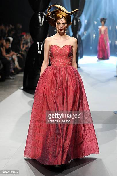 A model walks the runway at the Zareena show during Fashion Forward at Madinat Jumeirah on April 13 2014 in Dubai United Arab Emirates
