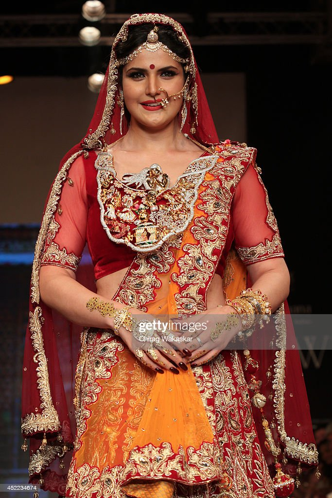 A model walks the runway at the <a gi-track='captionPersonalityLinkClicked' href=/galleries/search?phrase=Zarine+Khan&family=editorial&specificpeople=6381777 ng-click='$event.stopPropagation()'>Zarine Khan</a> show during day 2 of the India International Jewellery Week 2014 at grand Hyatt on July 15, 2014 in Mumbai, India.