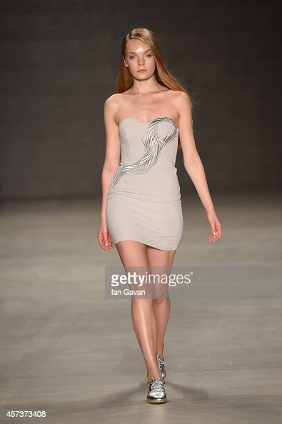 A model walks the runway at the Zeynep Erdogan show during Mercedes Benz Fashion Week Istanbul SS15 at Antrepo 3 on October 17 2014 in Istanbul Turkey