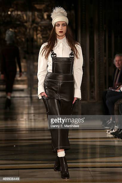 A model walks the runway at the Zeynep Tosun show at the Fashion Scout venue during London Fashion Week AW14 at Freemasons Hall on February 17 2014...