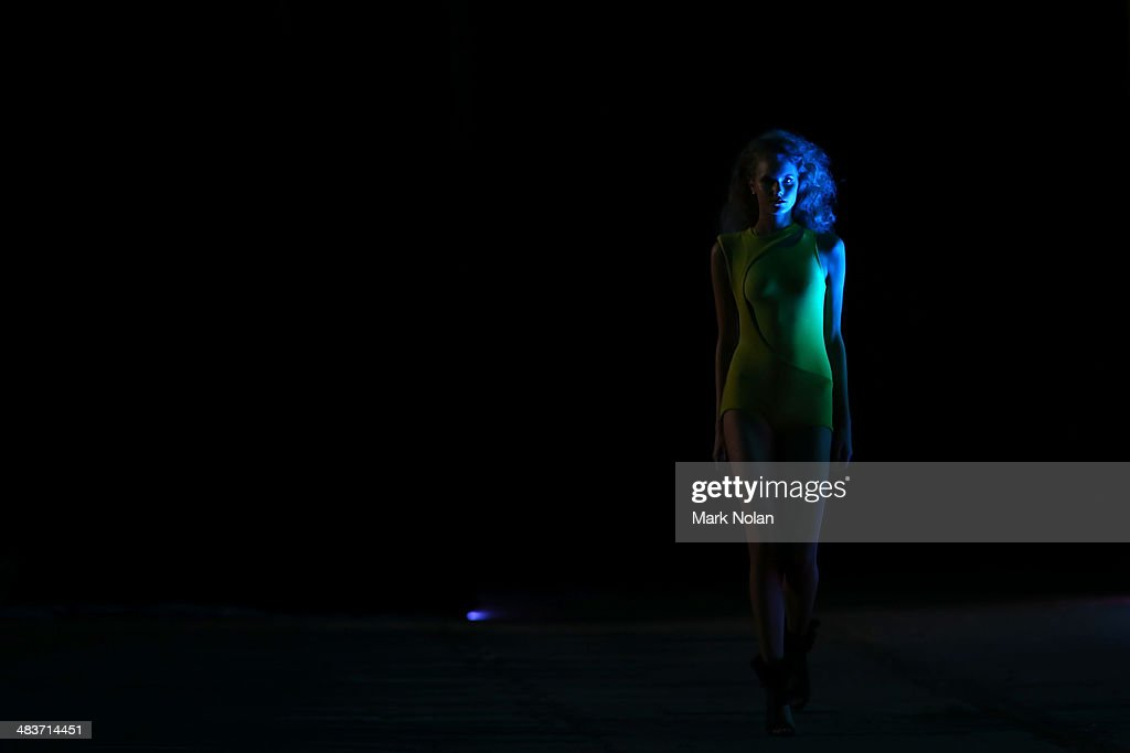 A model walks the runway at the Zhivago show during Mercedes-Benz Fashion Week Australia 2014 at the Paint Shop Building, Everleigh Suburban Car Workshops, on April 10, 2014 in Sydney, Australia.