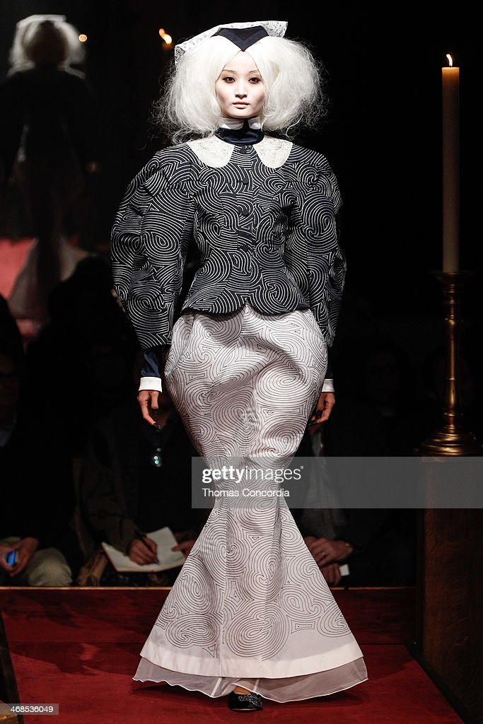 A model walks the runway at Thom Browne Women's during MercedesBenz Fashion Week Fall 2014>> at Center 548 on February 10 2014 in New York City