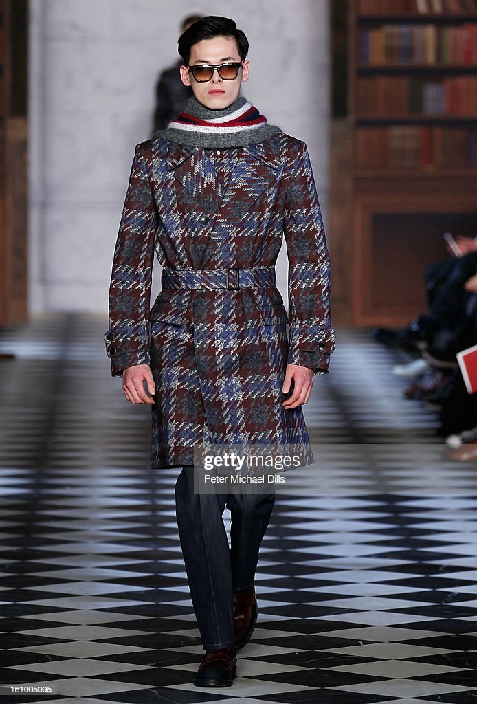 A model walks the runway at Tommy Hilfiger Men's Fall 2013 fashion show during Mercedes-Benz Fashion Week at Park Avenue Armory on February 8, 2013 in New York City.