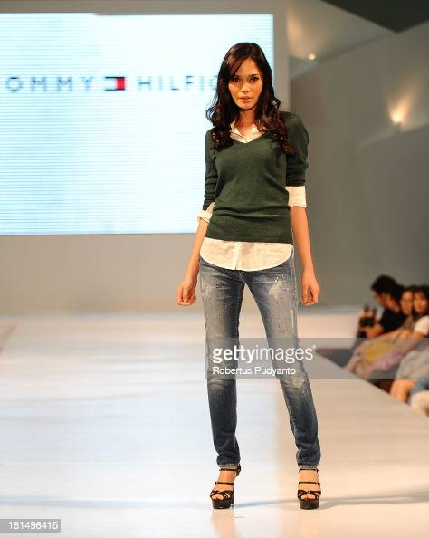 A model walks the runway at Tommy Hilfiger show during Ciputra World Fashion Week on September 21 2013 in Surabaya Indonesia