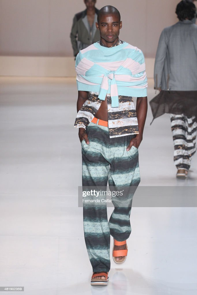 A model walks the runway at Triton show during Sao Paulo Fashion Week Summer 2014/2015 at Parque Candido Portinari on April 1, 2014 in Sao Paulo, Brazil.