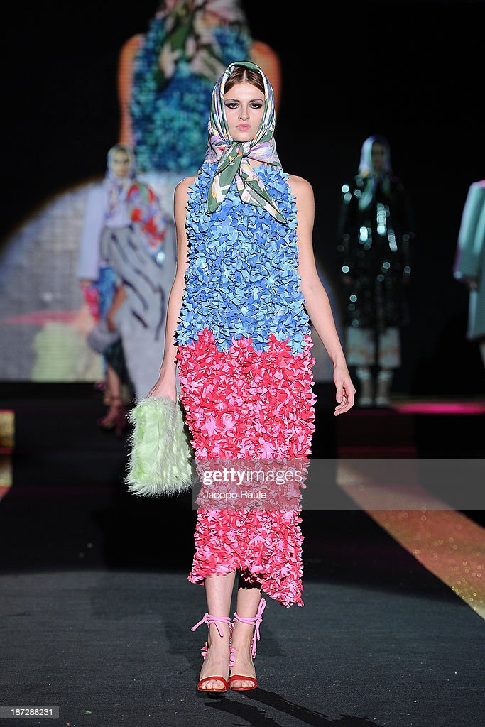 A model walks the runway at Virginia Burlina Fashion Show during the Mittelmoda Special Edition 2013 for Lectra on November 7, 2013 in Milan, Italy.