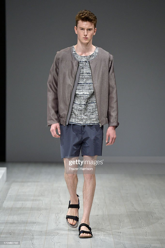 A model walks the runway at Vladimir Karaleev Show during Mercedes-Benz Fashion Week Spring/Summer 2014 at Brandenburg Gate on July 3, 2013 in Berlin, Germany.