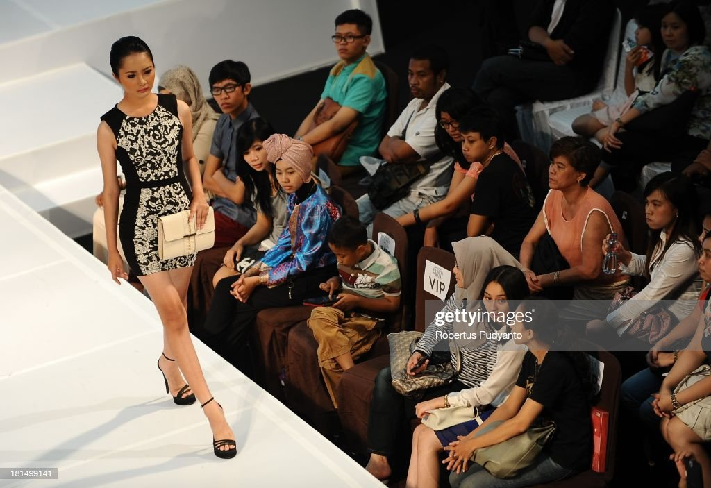 A model walks the runway at Warehouse Collection show during Ciputra World Fashion Week on September 21, 2013 in Surabaya, Indonesia.
