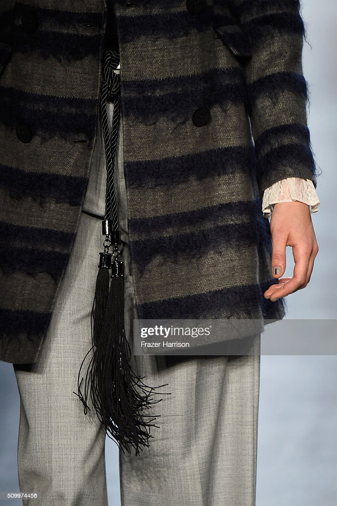 A model walks the runway, belt detail, wearing Taoray Wang Fall 2016 during New York Fashion Week: The Shows at The Dock, Skylight at Moynihan Station on February 13, 2016 in New York City.