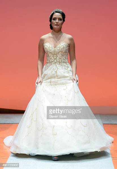 A model walks the runway during 2016 Alfred Angelo Disney Fairy Tale Weddings Bridal Collection fashion show debut on October 7 2015 in New York City