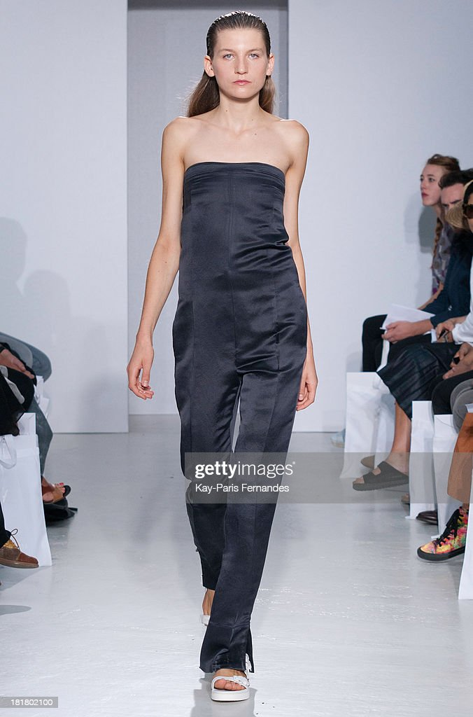 <<A model walks the runway during 22/4 Hommes Femmes show as part of the Paris Fashion Week Womenswear Spring/Summer 2014>> on September 25, 2013 in Paris, France.