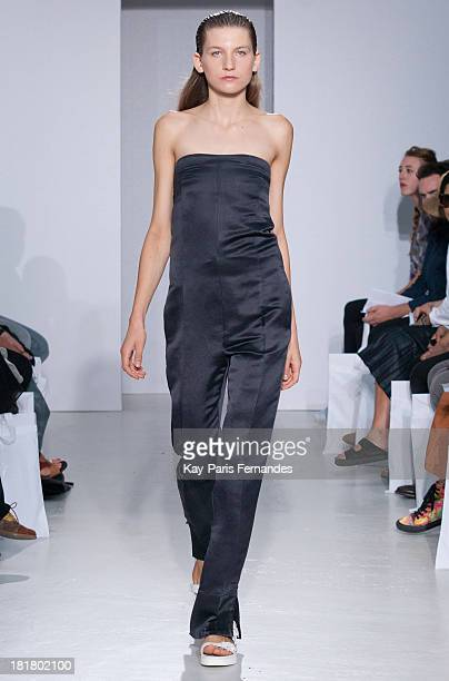 <<A model walks the runway during 22/4 Hommes Femmes show as part of the Paris Fashion Week Womenswear Spring/Summer 2014>> on September 25 2013 in...