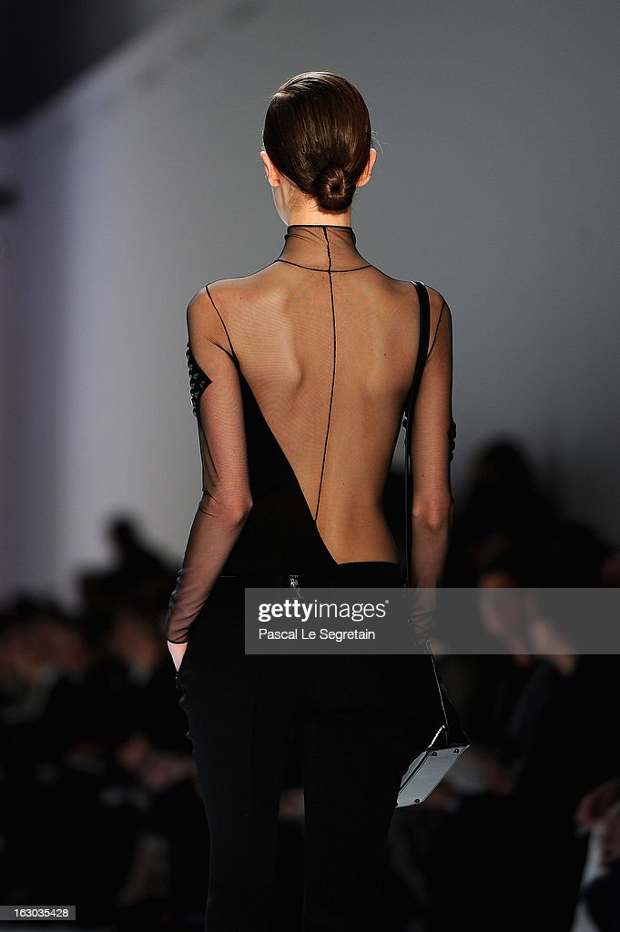 A model walks the runway during Akris Fall/Winter 2013 Ready-to-Wear show as part of Paris Fashion Week on March 3, 2013 in Paris, France.