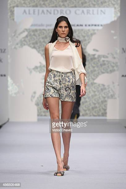 A model walks the runway during Alejandro Carlin show at MercedesBenz Fashion Week México Spring/Summer 2015 at Campo Marte on October 1 2014 in...