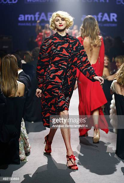 A model walks the runway during amfAR's 21st Cinema Against AIDS Gala Presented By WORLDVIEW BOLD FILMS And BVLGARI at Hotel du CapEdenRoc on May 22...