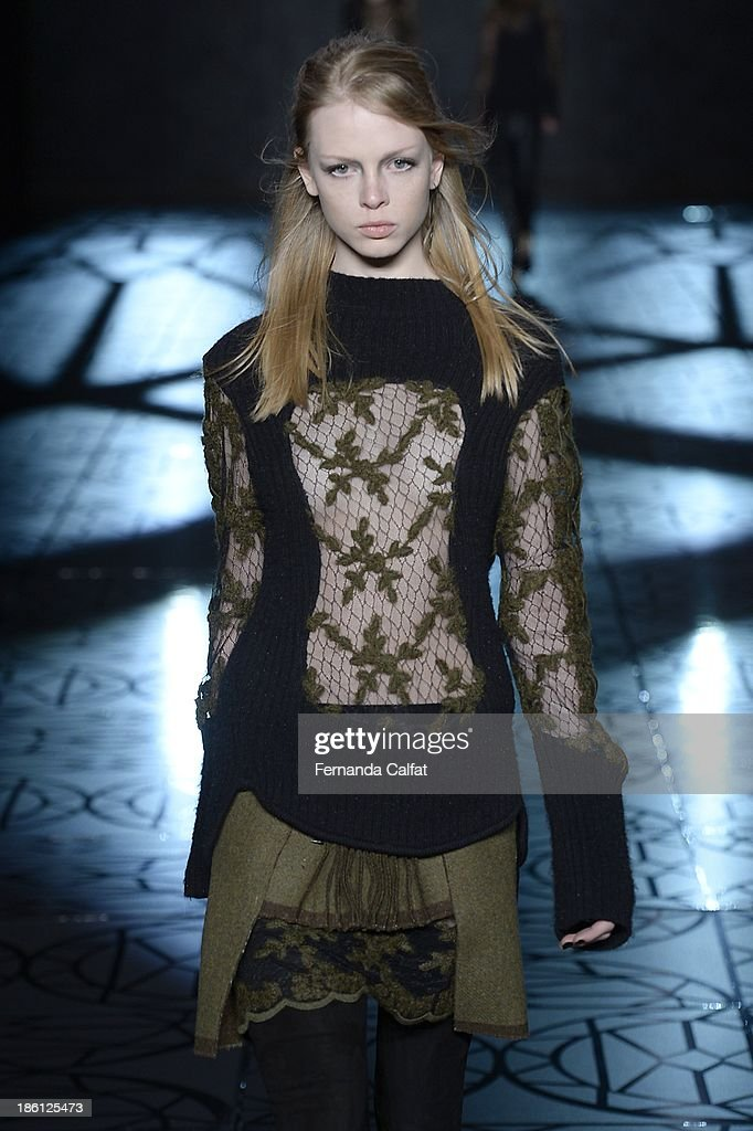 A model walks the runway during Animale show at Sao Paulo Fashion Week Winter 2014 on October 28, 2013 in Sao Paulo, Brazil.