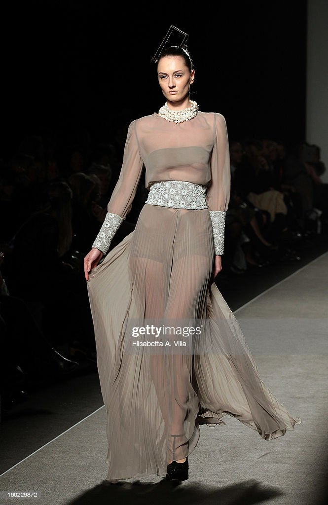 A model walks the runway during Atelier Persechino S/S 2013 Italian Haute Couture colletion fashion show as part of AltaRoma AltaModa Fashion Week at Santo Spirito In Sassia on January 28, 2013 in Rome, Italy.