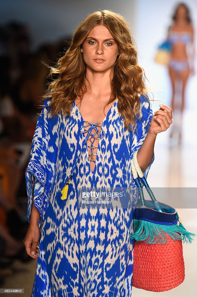A model walks the runway during Caffe Swimwear show at Mercedes-Benz Fashion Week Swim 2015 at Cabana Grande at The Raleigh on July 20, 2014 in Miami, Florida.