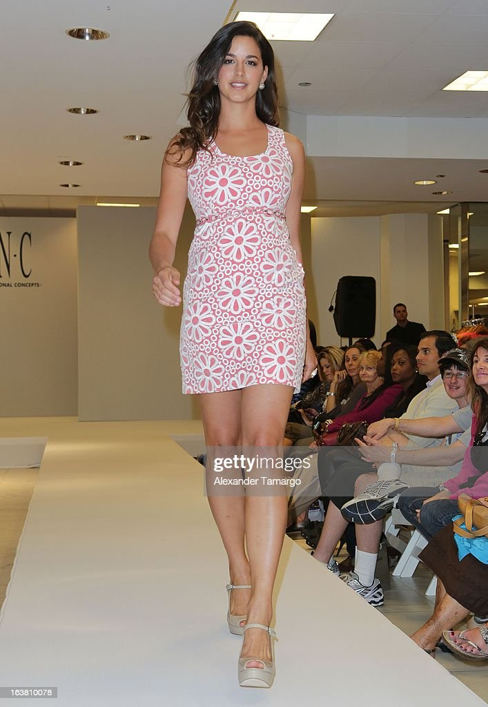 A model walks the runway during Camila Alves's appearance at Macys Aventura on March 16, 2013 in Miami, Florida.