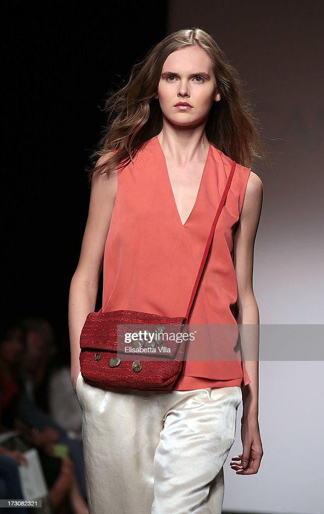 A model walks the runway during Cangiari S/S 2014 Haute Couture Handwoven eco-ethical colletion fashion show as part of AltaRoma AltaModa Fashion Week at Santo Spirito In Sassia on July 6, 2013 in Rome, Italy.