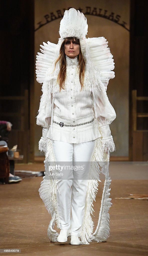 A model walks the runway during CHANEL 2013/14 'Paris-Dallas Metiers d'Art Collection' at Toranomon Hills on June 4, 2014 in Tokyo, Japan.