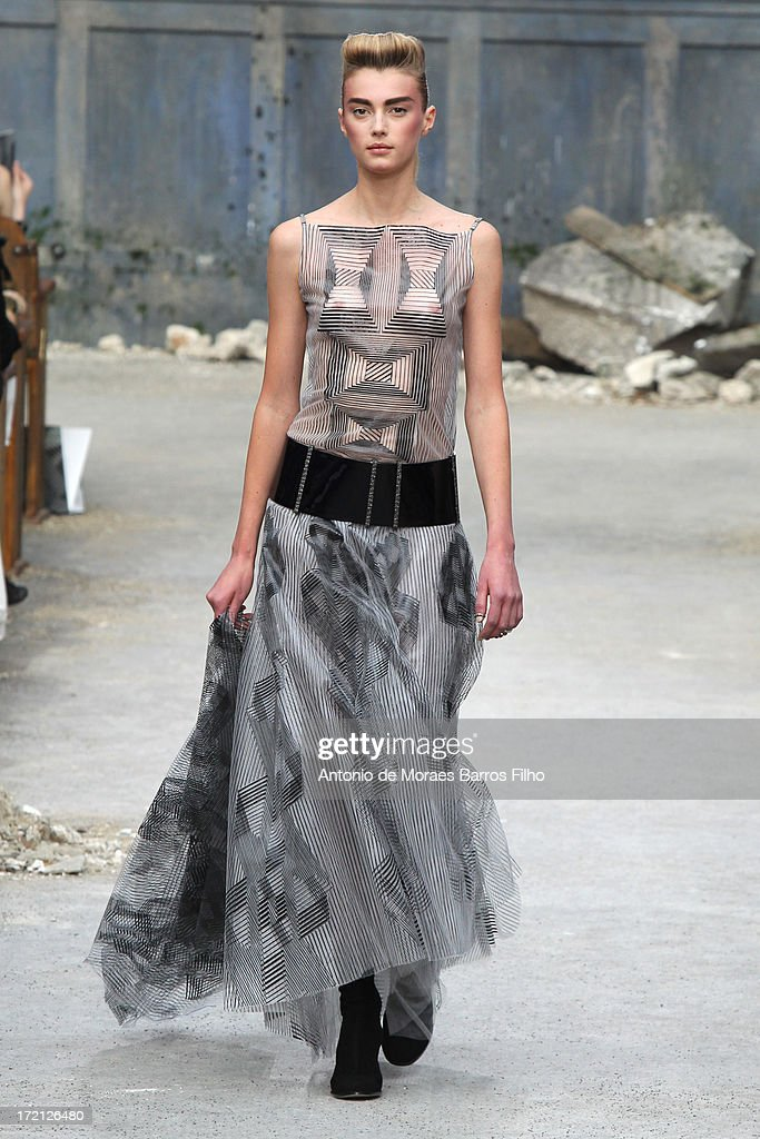 A model walks the runway during Chanel show as part of Paris Fashion Week Haute-Couture Fall/Winter 2013-2014 at Grand Palais on July 2, 2013 in Paris, France.
