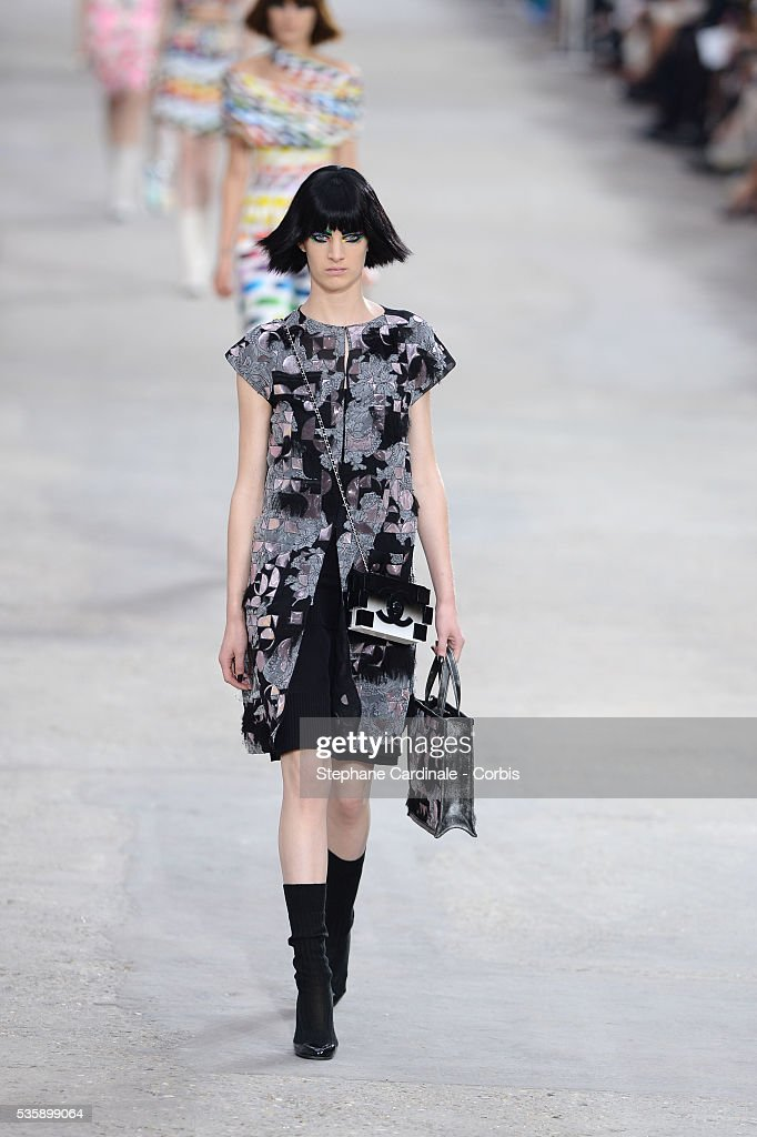 A model walks the runway during Chanel show, as part of the Paris Fashion Week Womenswear Spring/Summer 2014, in Paris.