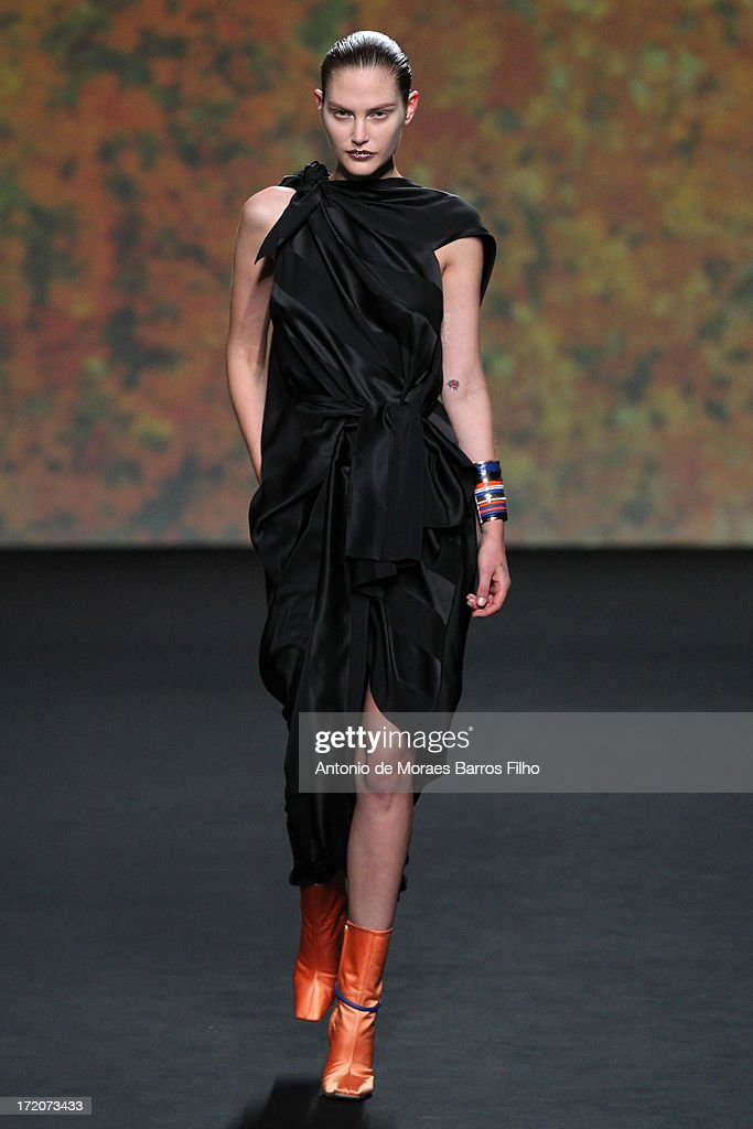 A model walks the runway during Christian Dior show as part of Paris Fashion Week Haute-Couture Fall/Winter 2013-2014 at on July 1, 2013 in Paris, France.