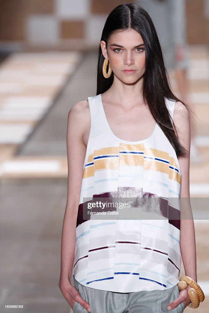 A model walks the runway during Cori show - Sao Paulo Fashion Week Summer 2013/2014 on March 18, 2013 in Sao Paulo, Brazil.