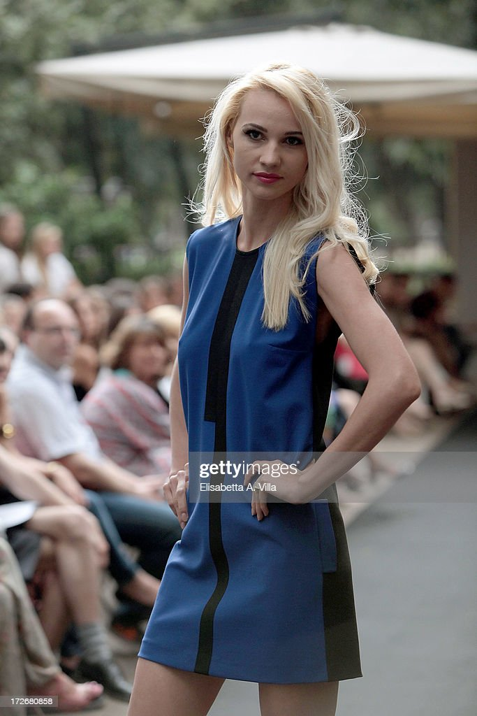 A model walks the runway during Croire .made by us. F/W 2013 colletion fashion show at Casina del Lago Villa Borghese on July 4, 2013 in Rome, Italy.