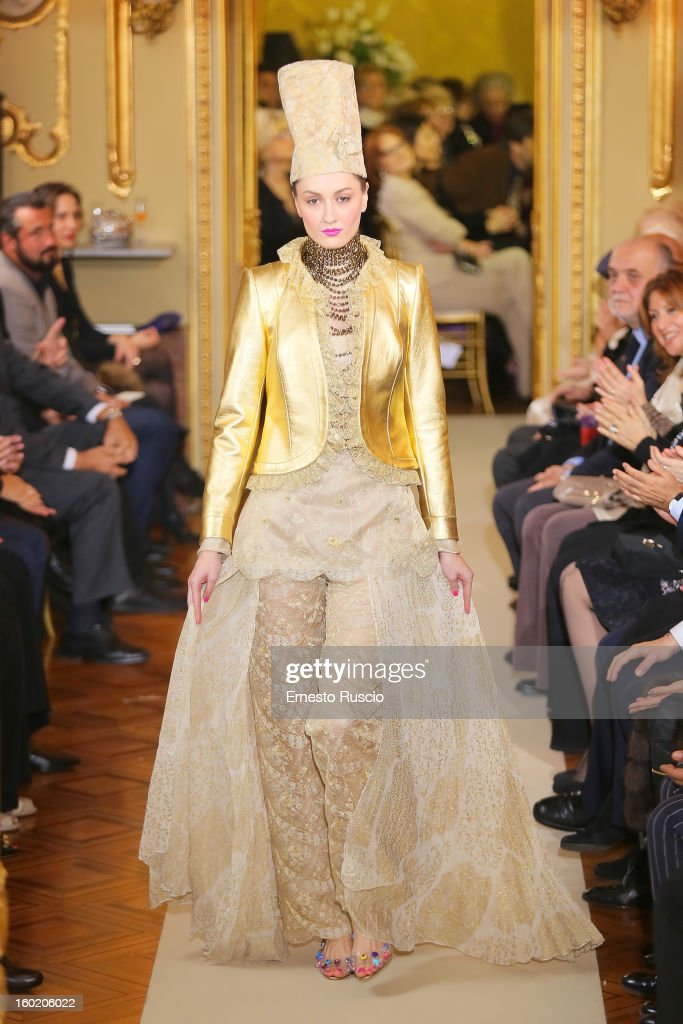 A model walks the runway during Curiel Couture fashion show as part of AltaRoma AltaModa Fashion Week on January 27, 2013 in Rome, Italy.