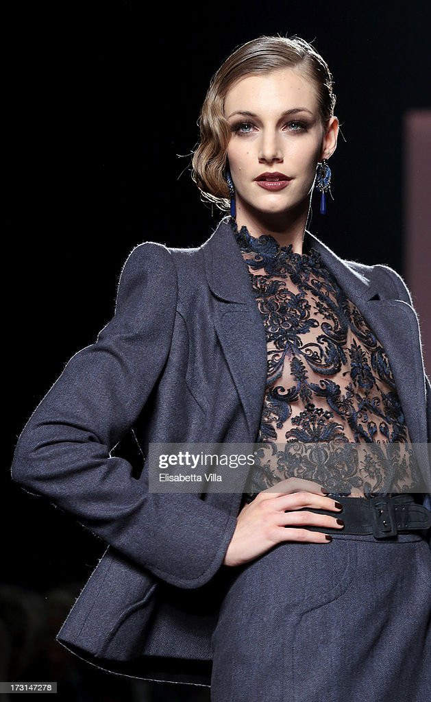 A model walks the runway during Curiel Couture F/W 2013-2014 Haute Couture collection fashion show as part of AltaRoma AltaModa Fashion Week at Santo Spirito In Sassia on July 8, 2013 in Rome, Italy.