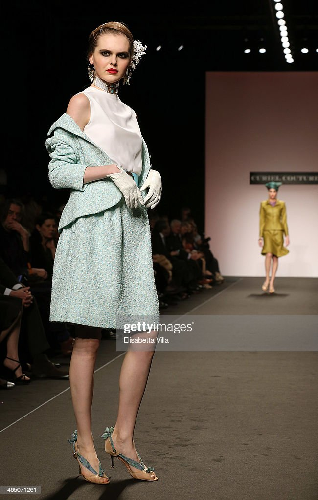 A model walks the runway during Curiel Couture S/S 2014 Italian Haute Couture collection fashion show as part of AltaRoma AltaModa Fashion Week at...