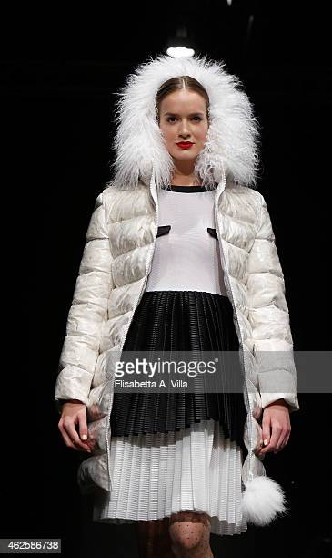 A model walks the runway during Daizy Shely F/W 20152016 colletion fashion show as part of AltaRoma AltaModa Fashion Week at Maxxi Museum on January...