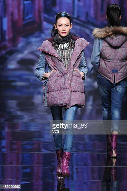 A model walks the runway during D'Nim show as part of MercedesBenz China Fashion Week Autumn/Winter Collection at Banquet Hall in Beijing Hotel on...
